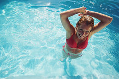 Woman making a splash in the pool Royalty Free Stock Photo