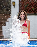 Woman making splash with water Stock Images