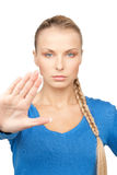 Woman making stop gesture Royalty Free Stock Image