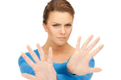 Woman making stop gesture Royalty Free Stock Images