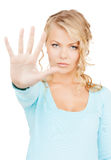 Woman making stop gesture Stock Photography