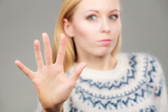 Woman making stop gesture with open hand Royalty Free Stock Photography