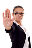 Woman making stop sign. Serious business woman making stop sign over white, focus on hand Stock Photography