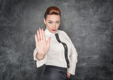 Woman making stop sign gesture Royalty Free Stock Images