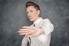 Woman making stop sign gesture Royalty Free Stock Photography