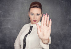 Woman making stop sign gesture Royalty Free Stock Image
