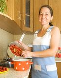Woman making strawberry jam Royalty Free Stock Photos