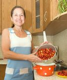 Woman making strawberry jam Stock Photos