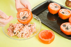 Woman making stuffed tomato Stock Image