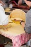 Woman Making talos, Tortilla than wraps txistorra. Stock Images