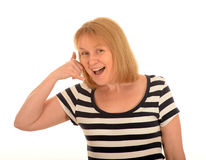 Woman making telephone gesture Royalty Free Stock Images