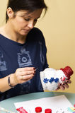 Woman making toy snowman stock image