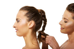 Woman making a tress her friend. Royalty Free Stock Images