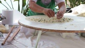 Woman Making Turkish Pancakes. Fast motion video shot of a woman makes traditional Turkish pancakes (gozleme stock video footage