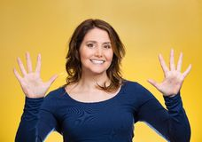 Woman making two times five sign gesture with hands, fingers, number ten royalty free stock images