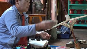 A woman making umbrellas in Inle, Myanmar stock video