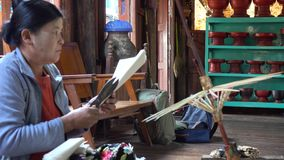 A woman making umbrellas in Inle, Myanmar stock video footage