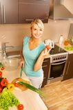 Woman making  vegetable salad Royalty Free Stock Photography
