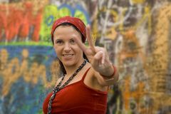 Woman making victory gesture. Pretty smiling woman making victory gesture Stock Image