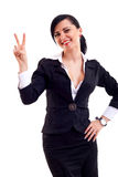Woman making the victory sign Stock Photo