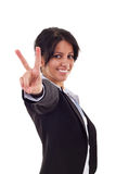Woman making the victory sign Royalty Free Stock Image
