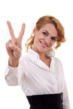 Woman making the victory sign Royalty Free Stock Photos