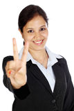 Woman making victory sign Royalty Free Stock Photos