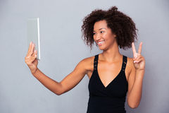Woman making video call on tablet computer Royalty Free Stock Photography