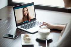 Woman making video call to girlfriend in cafe, close up Royalty Free Stock Photos