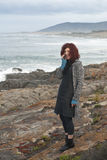 Woman making wild ocean phone call Royalty Free Stock Photo