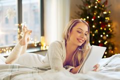 Woman making wish list at home on christmas royalty free stock photo