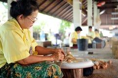 Woman making wooden umbrella. Taken at umbrella factory in Chiang Mai Thailand Royalty Free Stock Photos