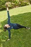 Woman making yoga as fitness training royalty free stock images