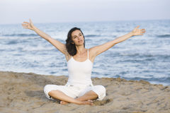 Woman making yoga exercise on the beach Royalty Free Stock Photography