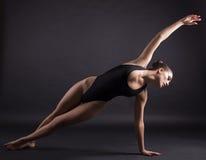Woman making yoga exercise Stock Image