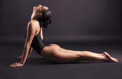 Woman making yoga exercise Royalty Free Stock Photos