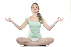 Woman making yoga- exercises Royalty Free Stock Photo