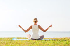 Woman making yoga exercises outdoors Royalty Free Stock Image