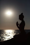 Woman making yoga figure. Royalty Free Stock Photography