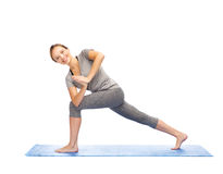 Woman making yoga low angle lunge pose on mat Royalty Free Stock Photography