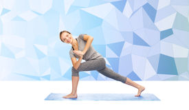 Woman making yoga low angle lunge pose on mat Royalty Free Stock Photos