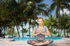 Woman making yoga meditation in lotus pose Royalty Free Stock Photo