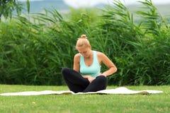 Woman making yoga Stock Photos