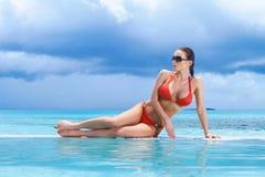 Woman at Maldives. Beautiful woman resting near pool at Maldives Stock Photography