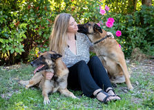Woman and malinois. Woman and belgian shepherd malinois in a garden Royalty Free Stock Photo