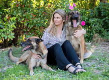 Woman and malinois. Woman and belgian shepherd malinois in a garden Stock Images
