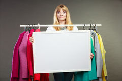 Woman in mall wardrobe with blank banner copyspace Stock Photo