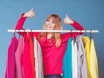 Woman in mall or wardrobe with thumbs up gesture. Stock Photo