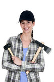 Woman with a mallet Stock Photos