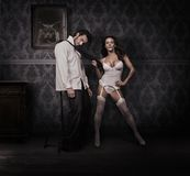Woman and man. Dominating woman and handsome man Royalty Free Stock Images